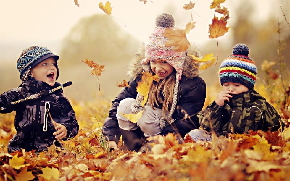 6909438-happy-kids-nature-autumn-leaves-photo